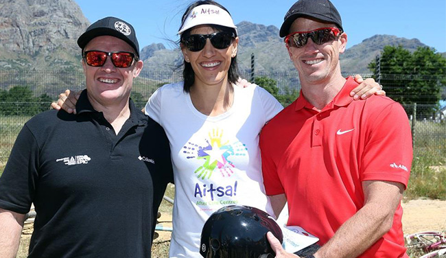 Handover: L – Bianca Grobbelaar AITSA, M – Chris Norton BMT and Adam Brooke Absa Sponsorship Manager