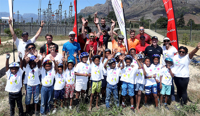 Absa Pride Riders with the AITSA staff and kids